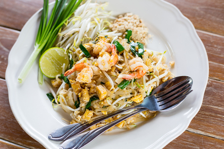 Pad Thai noodle food on the wood board. Stock Photo