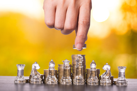 battle plan: Money game chess currency for leadership in the world business.