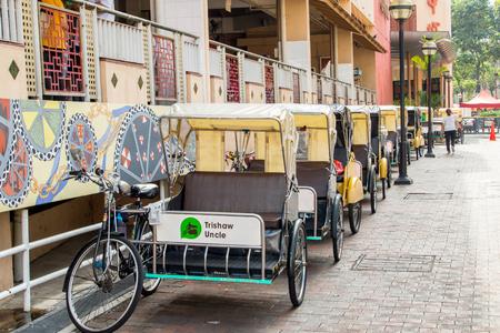 trishaw: CHINA TOWN,SINGAPORE - Aug 29 ,2016: Trishaw bike stop for wait tourist people in Singapare.