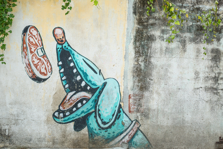 GEORGE TOWN,PENANG ,MALAYSIA- CIRCA March 26, 2015: Public street art dog eating meat food on the wall with in Georgetown, Penang, Malaysia. Editorial