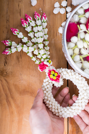 Songkran festival, Thai people prepare water perfume with flower on Thailand New Year. Stock Photo