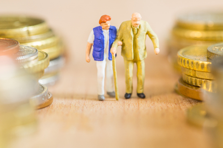 Retire elderly man take care by nursing home nurse with coin stack background