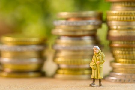 Elderly women figurine walking alone with money background