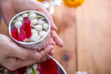 Songkran festival, Thai people prepare water perfume with flower on Thailand New Year. Standard-Bild