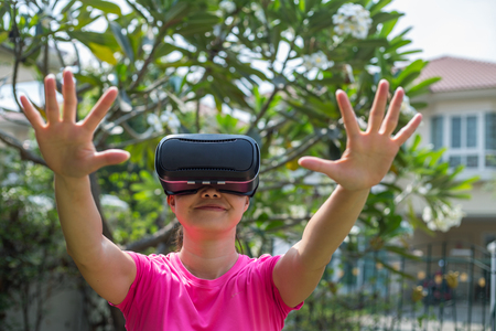 Asian people using VR for watch and play game at home. Stock Photo