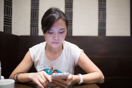 Asian woman using phone for chat and search information before go to Airport. Stock Photo