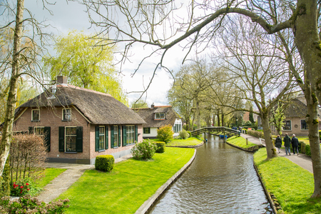 GIETHOORN, NETHERLANDS - April 22,2017: Tourist boat travel and visit Giethoorn village where call Venice of the North in Netherlands.