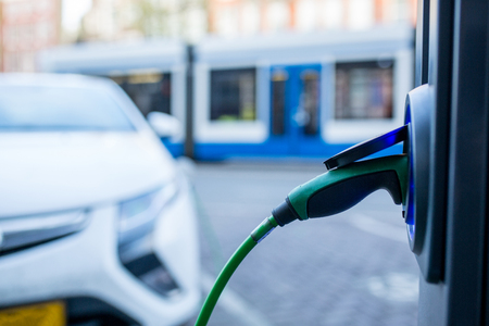 Electric car charger changing power  in Amsterdam ,Netherlands. 版權商用圖片
