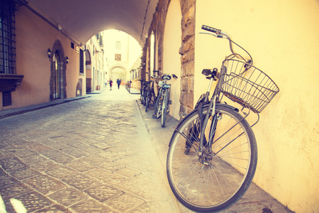 autumn colour: Vintage bike beside the street in Florence Italy