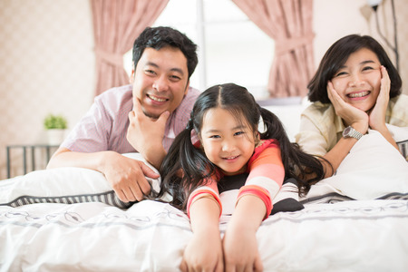 cute guy: Asian family happy do activity together at home.