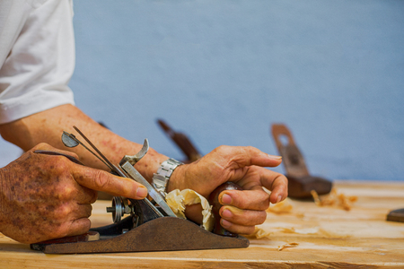 Carpenter working for timber table wooden at home. Stock Photo