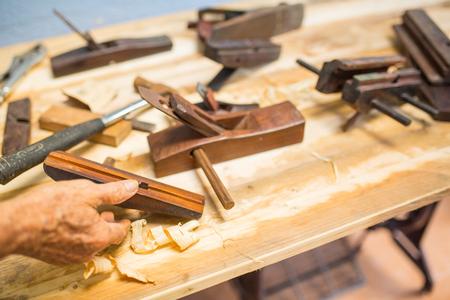 Wood carpenter working timb furniture in room workshop. Stock Photo