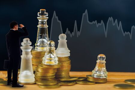 competition business strategy chess game for investment money. Standard-Bild