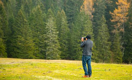 Photographer holding DSLR camera for take a picture in Bolzano ,Italy. Standard-Bild