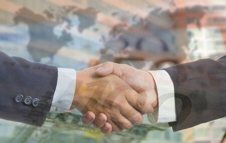 Businessman shake hands for deal thier business in European