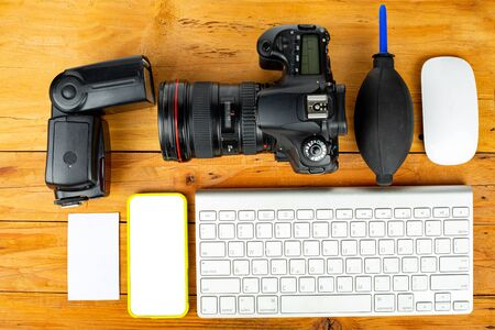 Business photographer equipment and design with DSLR camera.