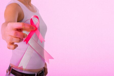 Pink ribbon icon background for prevent cancer day. Standard-Bild