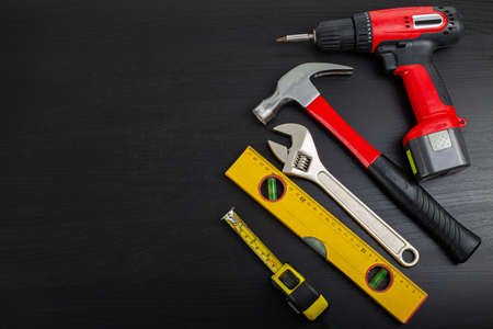 Different construction tools for your home and renovation on wooden board maintenance and repair Standard-Bild