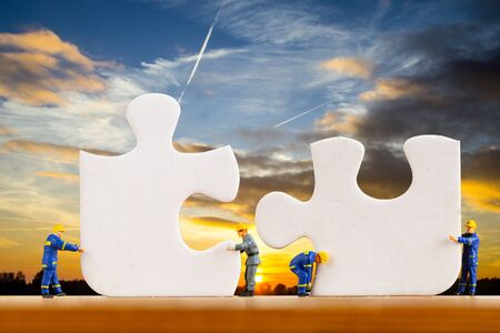 Teamwork jigsaw for support together in twilight time.