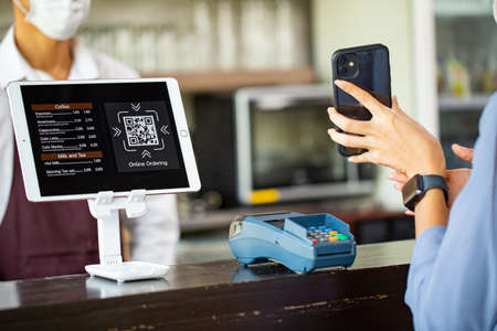 Customer using smartphone for payment with contactless for prevent touching by transfer money with phone. Standard-Bild