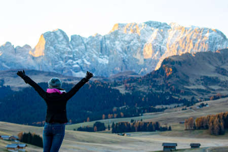 A woman happiness after arrived landmarks of natural Bolzano ,Italy.Travel photo nature of landscape.