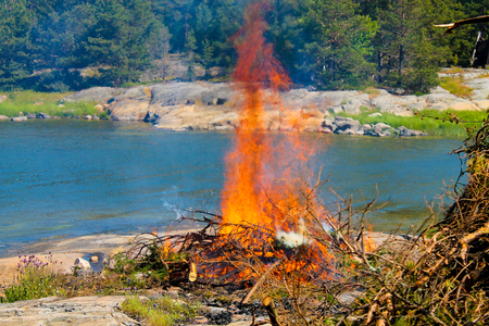 A large bonfire in the archipelago in the summer