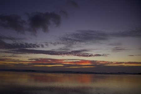 Sunset at Bethells Beach in Auckland New Zealand