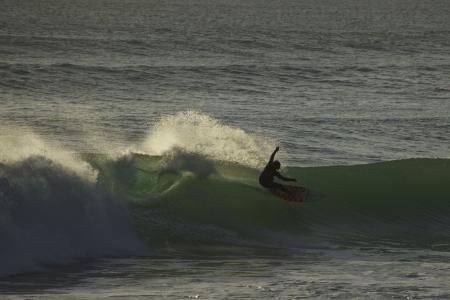 Surfing Bethells Beach New Zealand