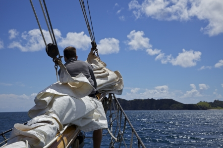 Riding the bow of a sailboat among the Bay of Islands in New Zealand