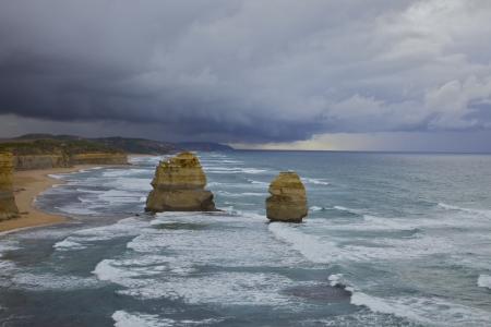 Storm on the horizon on the Great Ocean Road in Australia. Overlooking two of the twelve apostles Stock Photo - 16731594