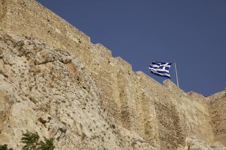Greek flag flying on the acropolis. Athens, Greece