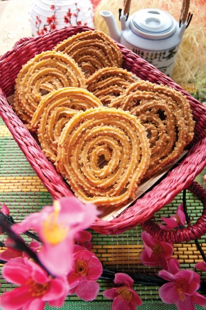 Traditional crispy Murukku served in a basket photo
