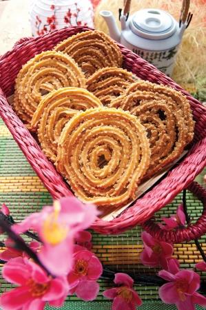 murukku: Traditional crispy Murukku served in a basket