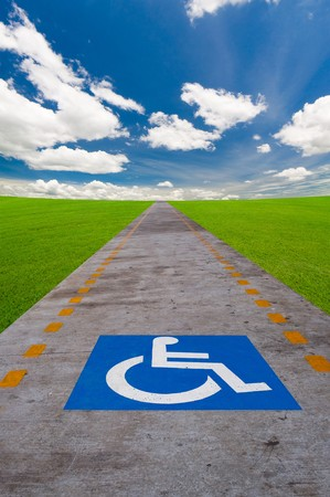 wheelchair access: disabled sign board on the way