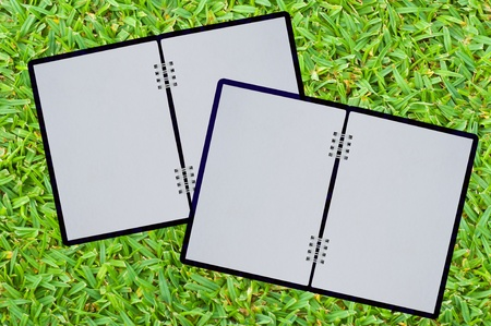 note book on green grass  Stock Photo - 9362292