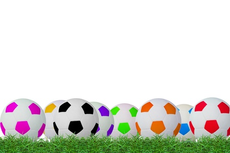 isolated footballs on green grass photo