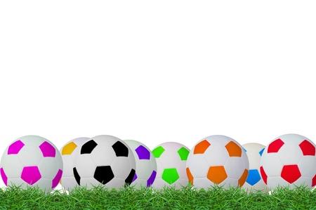 isolated footballs on green grass photo