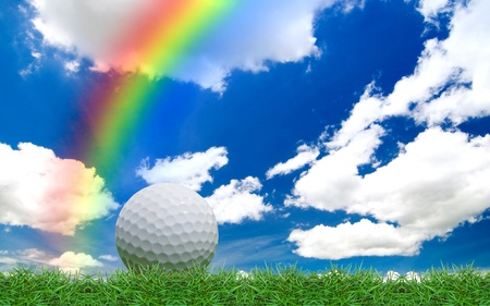 isolated golf ball on green grass field Stock Photo