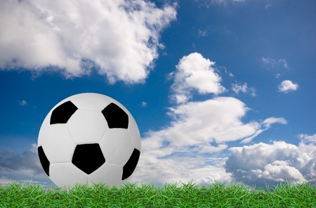 football on green grass under the blue sky