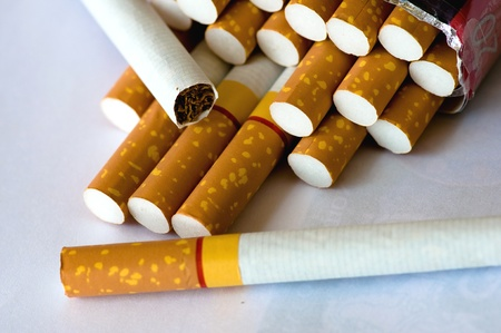 many cigarettes on white background
