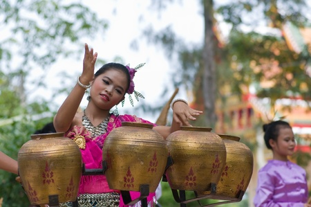 Hua Hin, THAILAND - November 5 : Unidentified young Thai woman is performing traditional Thai folk dance with traditional thai northeastern music instrument (Pongrang) ) during Buddha day festival on November 5, 2011 at Borfai Temple in Hua Hin Thailand. Editorial