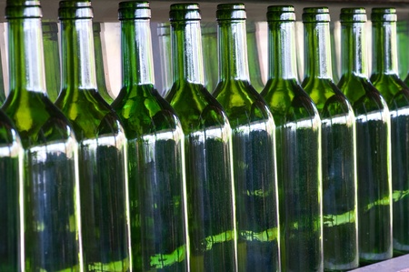 row of green bottles Stock Photo