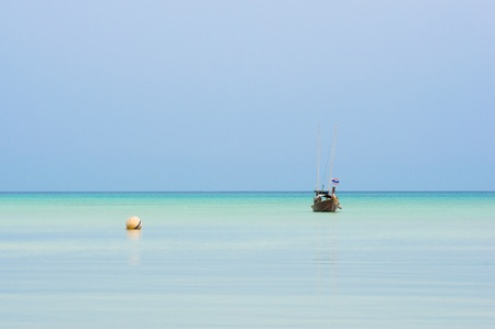 a small fishing boat near Surin island ,Southern of Thailand photo