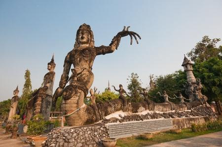 god figure: stucco ancient architecture in Sala Kaew Ku - Thai temple in hindu style, Nhongkhai Province Thailand