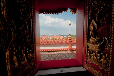 Arts on windows of Phramahathat Khannakhon tower, Khonkaen Province in Northeastern of Thailand Stock Photo - 12818996
