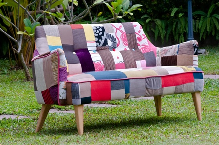 colorful sofa in a green garden Stock Photo