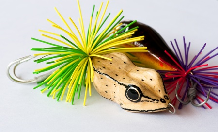 colorful fishing lures on white background photo