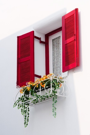 red vintage windows in Greek Style