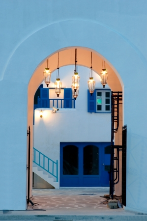 vintage light lamp on the wall in greek style photo