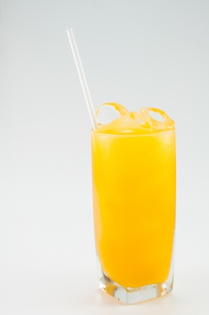 a glass of orange juice on white background photo